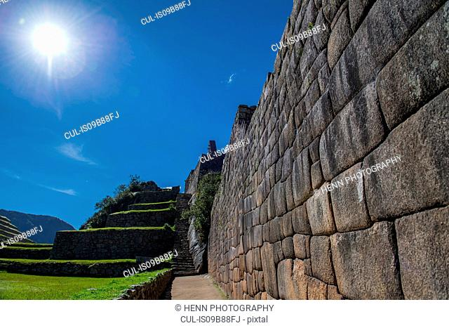 Stone wall at inca ruins, Machu Picchu, Cusco, Peru, South America