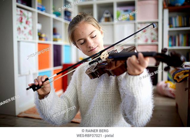 Girl exercising on her violin