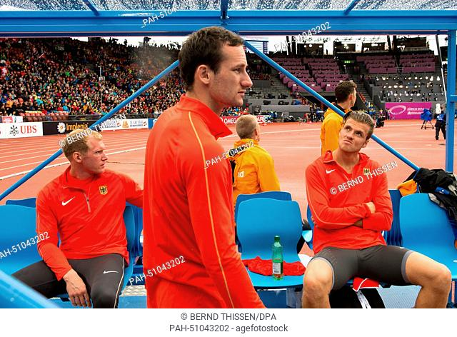 The three german athletes Arthur Abele, Kai Kazmirek and Rico Freimuth (L-R) wait for their next attemps in the Discus Throw event of the Decathlon competition...