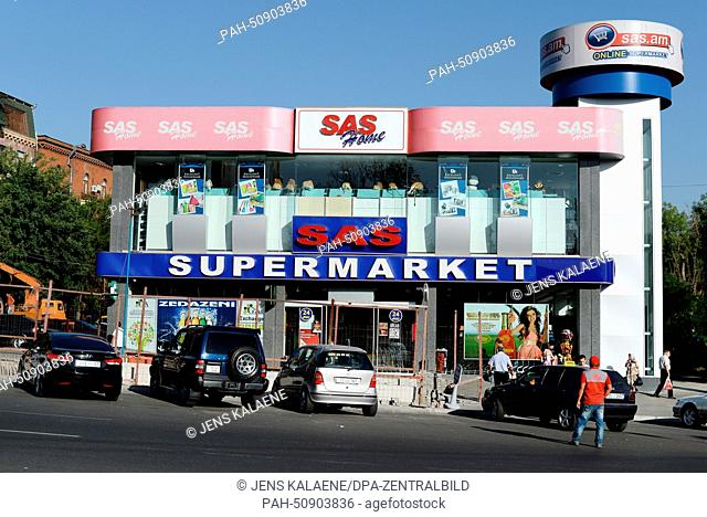 Cars park in front of a SAS supermarket in Yerevan, Armenia, 22 June 2014. Supermarkets in Yerevan are usually open 24 hours a day and employ numerous staff who...