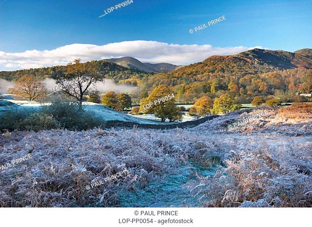 England, Cumbria, Elterwater, A view toward Elterwater lake. Sometimes known as the lake of the swans and dominated by the twin peaks of Harrison's Sickle and...