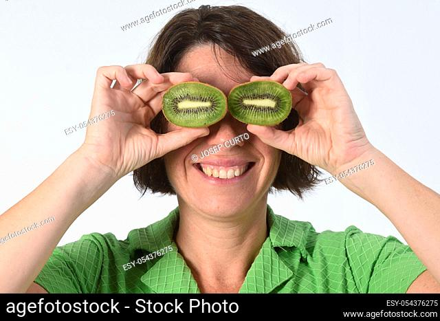 woman with kiwi on white background