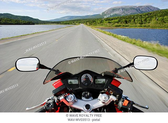 View on Motorcycle in action and Gros Morne Mountain, Gros Morne NP, Newfoundland, Canada