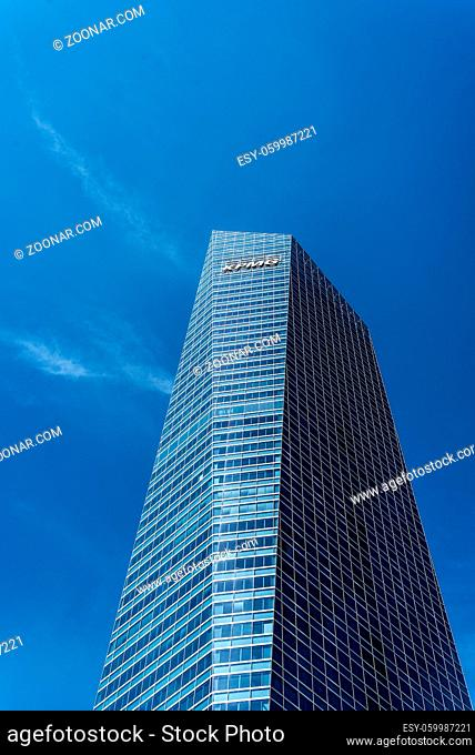 Madrid, Spain - June 14, 2020: Skyscraper against blue sky in Four Towers Business Area. Torre de Cristal