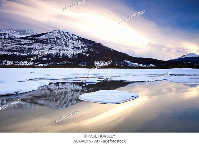 Scenic snow capped mountain reflected in the Athabasca River, Jasper National Park, Canada