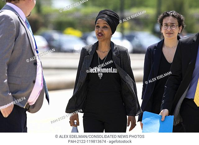 United States Representative Ilhan Omar, Democrat of Minnesota, walks with staff to a press event in front of the United States Capitol in Washington, D