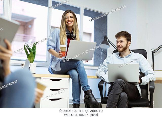 Coworkers in the office having an informal meeting