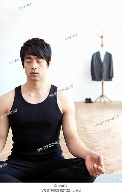 Asian Man Doing Yoga