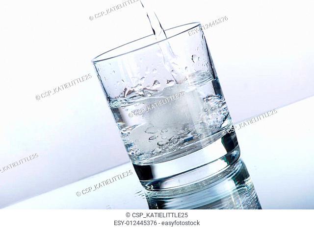 Liquid pouring into a tumbler