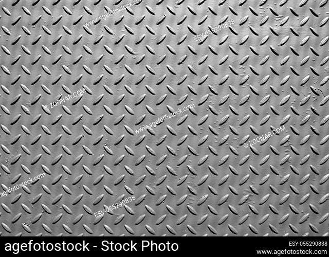 grey steel metal plate with painted surface and industrial safety diamond pattern texture