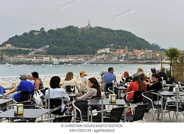 outside restaurant La Perla on Paseo de La Concha with the Santa Clara island in the background, San Sebastian, Bay of Biscay, province of Gipuzkoa