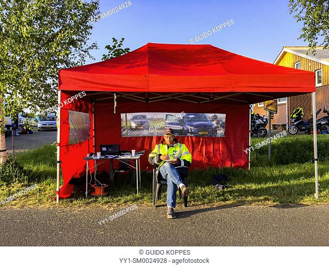 Coevorden, Netherlands. Male volunteer at checkpoint alongside the Roparun 2018 Route between Hamburg and Rotterdam