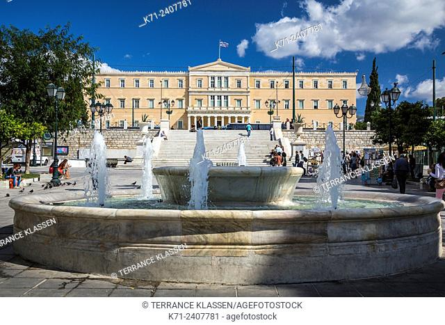 Decorative water fountains and the Parliament buildings at Syntagma Square, Athens, Greece, Europe