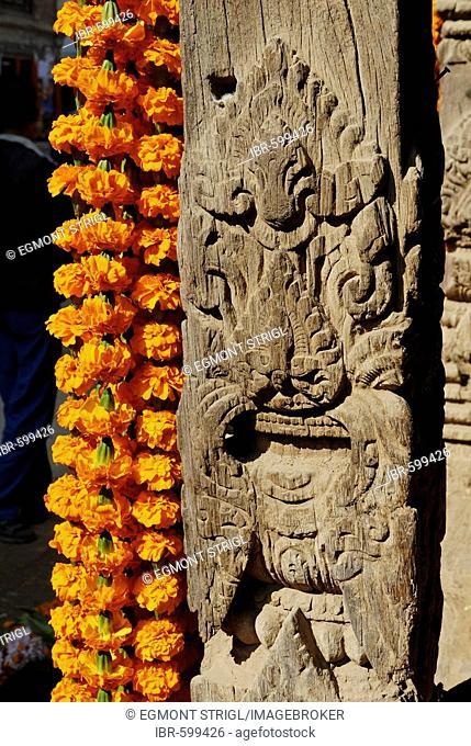 Carved wooden coloumn with flower decoration, Patan, Kathmandu, Nepal