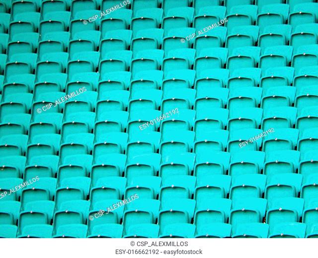 light green stadium chairs background