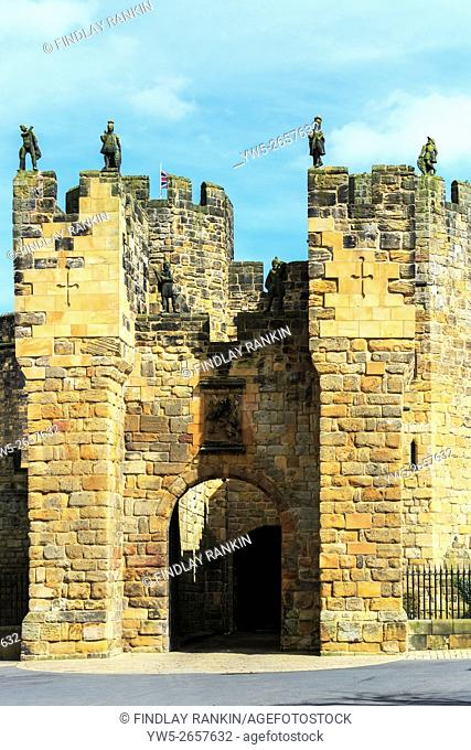 Front portal of Alnwick Castle, Northumberland, England showing statues and turrets