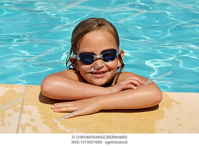 Girl with Diving Goggles in a Swimming Pool