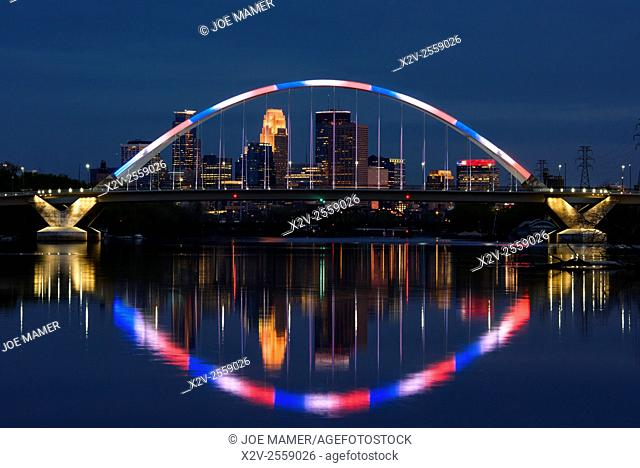 Lowry Avenue bridge at dusk with blue and red lighting