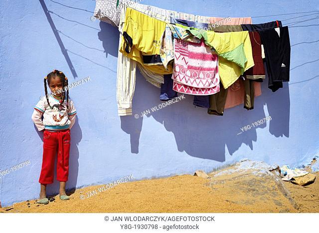 Egypt - Nubian village near Aswan, Nubian child standing before her house, South Egypt