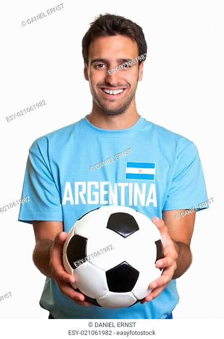 Laughing argentinian man with football