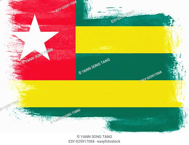 Flag of Togo painted with brush on solid background
