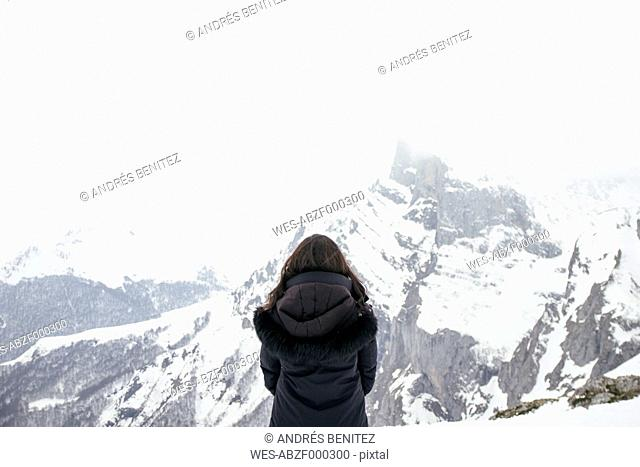 Woman in front of a snowy mountain in Picos de Europa