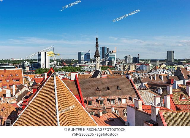 View over the old town of Tallinn to the town hall tower. In the background are the modern houses in the new town to see, Tallinn, Estonia, Baltic States