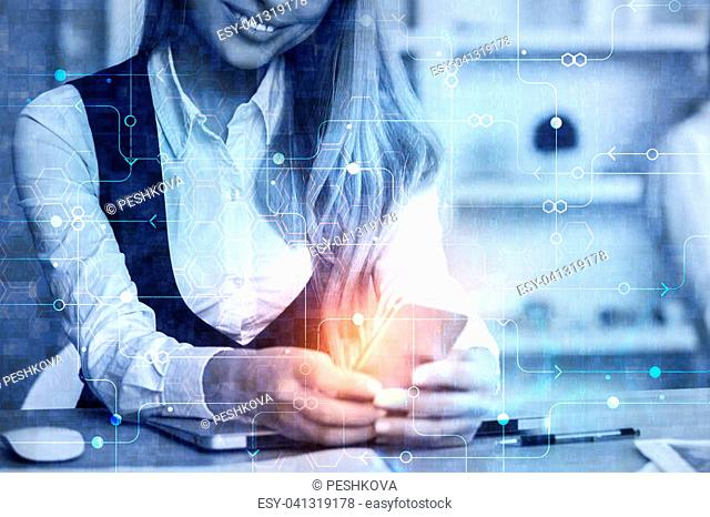 Close up of female hands using smartphone at modern workplace with abstract digital interface. Accounting and innovation concept. Double exposure