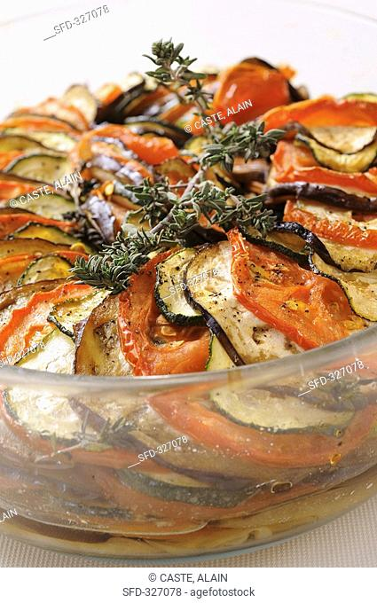 Baked tomato, aubergine and courgette slices in olive oil