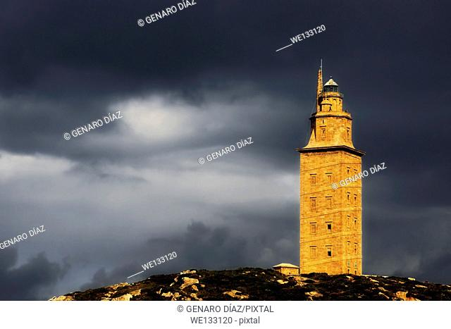 Tower of Herculesat sunset with dark clouds, World Heritage Site, roman lighthouse, La Corunna, Galicia, Spain