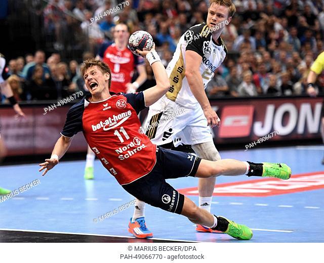 Flensburg's Lasse Svan (L) throws the ball in front of Kiel's Aron Palmarsson during the Champions League EHFFinal Four final handball match between THW Kiel...