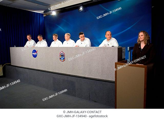 The STS-117 crewmembers along with moderator Kylie Clem (right) are photographed during a pre-flight press conference at Johnson Space Center