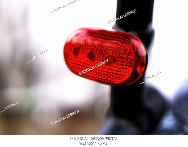 Horizontal vivid rear bike red light bokeh background backdrop