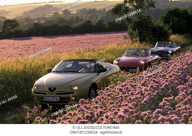 Car, 90 years Alfa Romeo, landscape, scenery, summer, vintage car, 1960s, sixties, yellow, Alfa Romeo Spider 2.0 Twin Spark, convertible, model year 2000, red