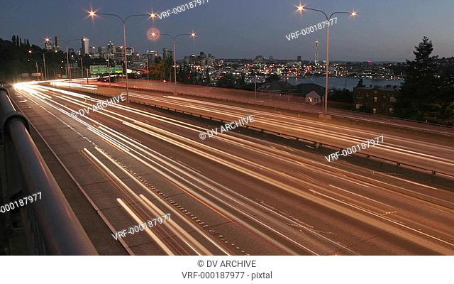 Traffic drives along a Seattle freeway at night