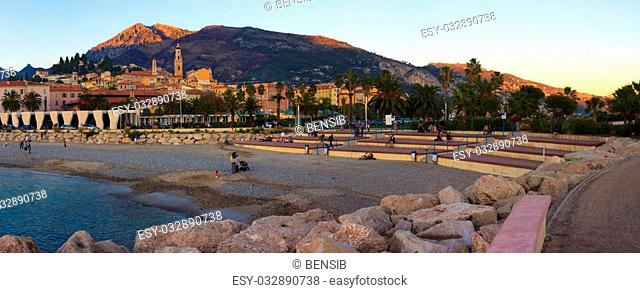 Beautiful Sunset on the beach and the town of Menton, French Riviera