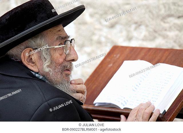 old jew praying at western wall in jerusalem