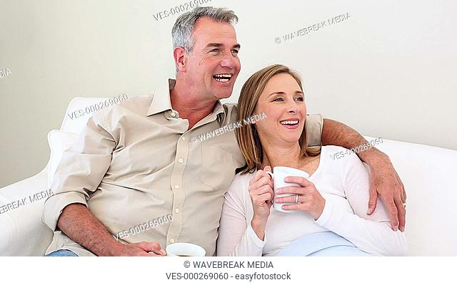 Couple drinking coffee on the couch