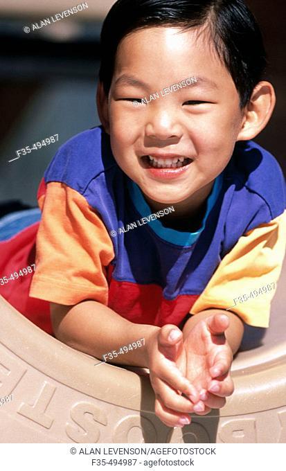 Happy Asian Boy at the Park