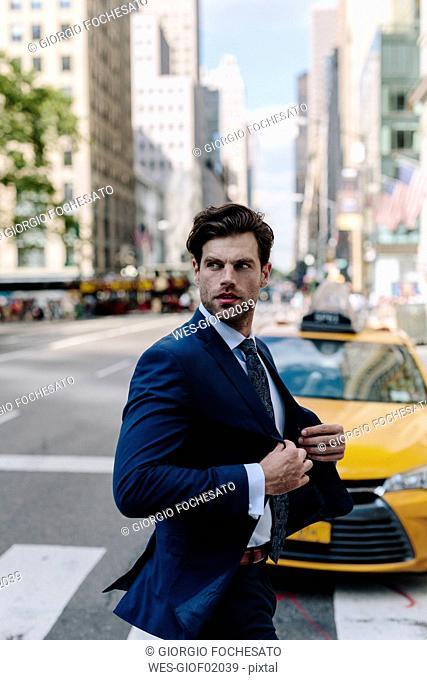 Handsome businessman walking in Manhattan
