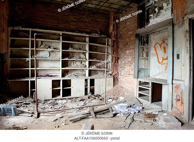 Rubble and graffiti in abandoned, deteriorating building