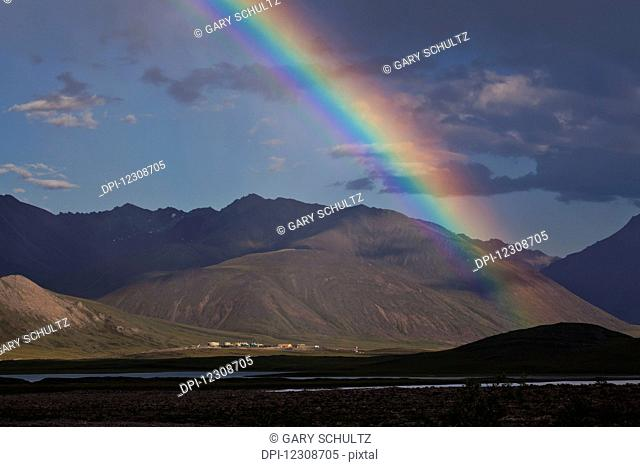 Rainbow over Trans Alaska Pipeline System Pump Station 4, Brooks Range north of Atigun Pass, Northern Alaska; Alaska, United States of America