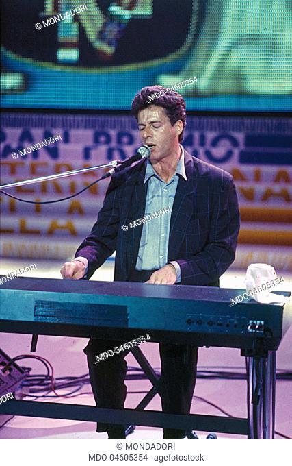 The italian singer and songwriter Claudio Baglioni plays the piano during his exhibition at the Gran Premio Internazionale della Tv - Notte dei Telegatti
