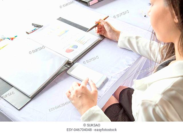 Business woman working check business report. The blank screen with copy space for your text or advertising content. Selective focus