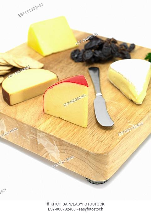 A selection of cheeses on a cutting board