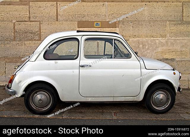 Old white Fiat 500 on Paris street