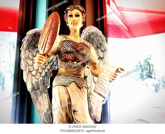 An image of an angel holding a feather and a parchment decorates Pan Gabriel bakery in Colonia Condesa, Mexico City, Mexico