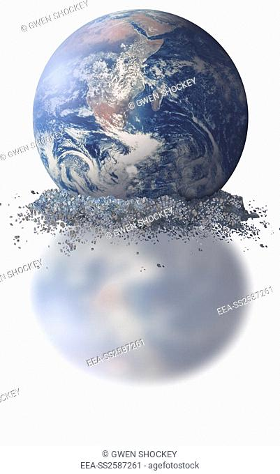 Crumbling Earth. Conceptual artwork of a crumbling Earth, possibly a commentary on the effects of climate change