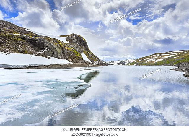 ice on a mountain lake and snowed mountains, Norway, Vikafjellsvegen, Riksvei, Rv 13