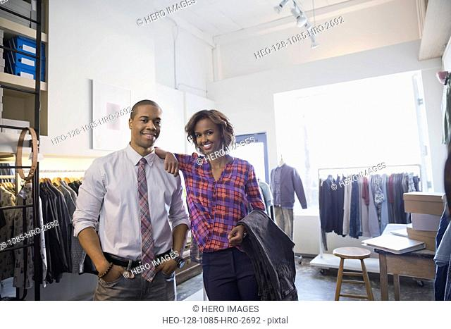 Portrait of confident business owners in clothing shop